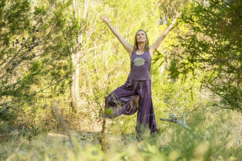 Lisa Fabry Nutrition & Yoga Therapy woman doing yoga in Australian bush
